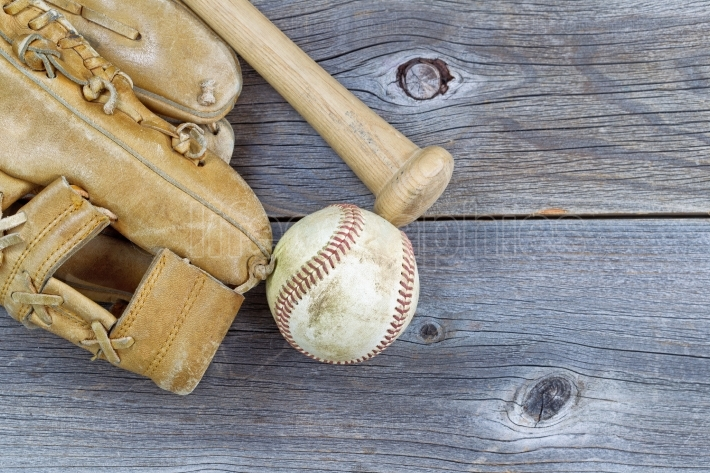 Old Baseball equipment on Aged Wood