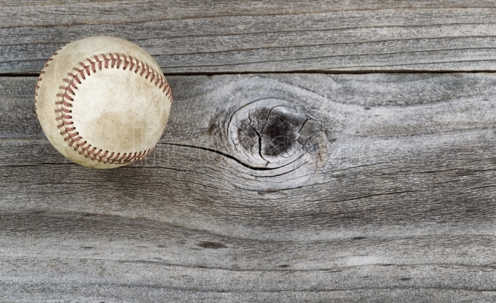Old Baseball on weathered wood