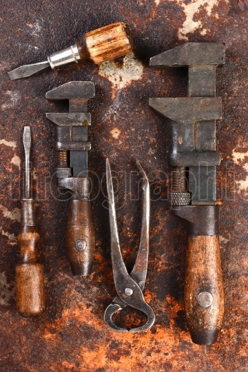 Old Hand Tools on Rusty Surface