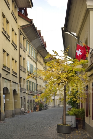 Old Unesco city of Bern with Switzerland and Bern flag. Switzerland