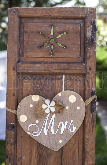 Old wooden shutter windows with hanging heart for Mrs