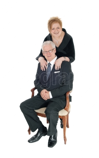 Older couple smiling.