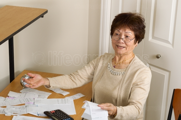 Older woman frustrated with her financial bills