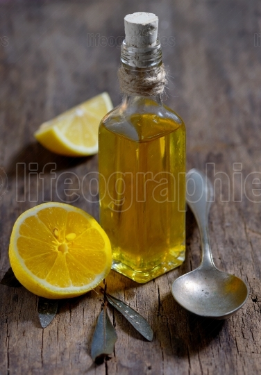 Olive oil and  lemon fruits on the wooden table