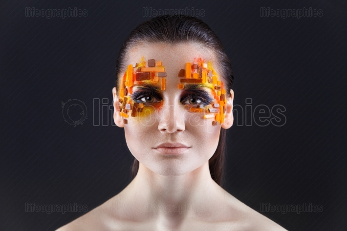 Orange and Red Rhinestones on a Girl Face