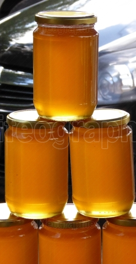 Organic honey in jars in a farmers market