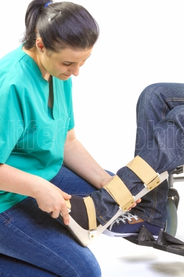 Orthopedic equipment for young man in wheelchair