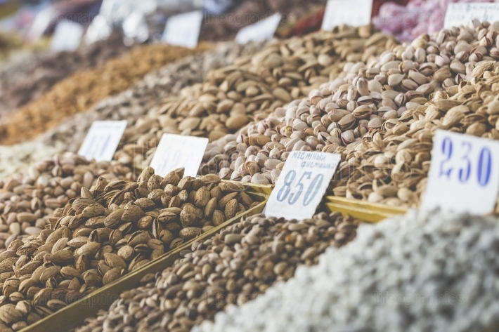 Osh bazaar in Kyrgyzstan - nuts and raisins for sale.