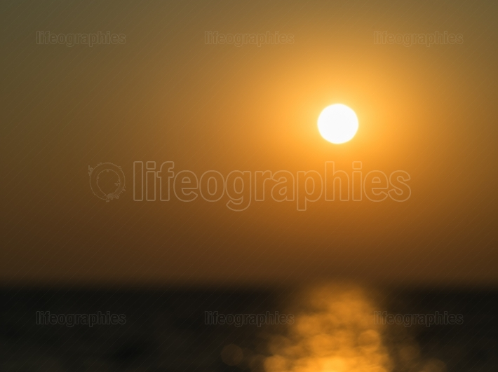 Out of focus golden ocean sunset