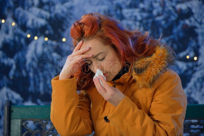 Outdoors portrait of  young woman sick colds,flu,fever