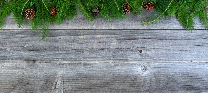 Overhead view of real Christmas fir tree branches on weathered w