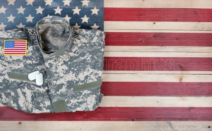 Overhead view of USA military uniform on rustic wooden flag