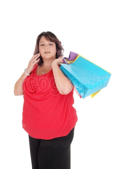 Overweight woman holding her shopping bag s