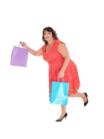 Overweight woman running with bag s