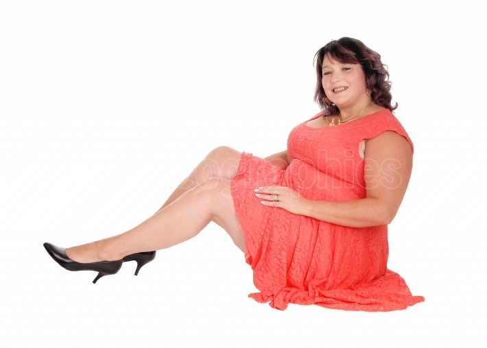 Overweight woman sitting on floor