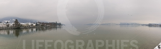 Panoramic view of the Thun Lake on a foggy day