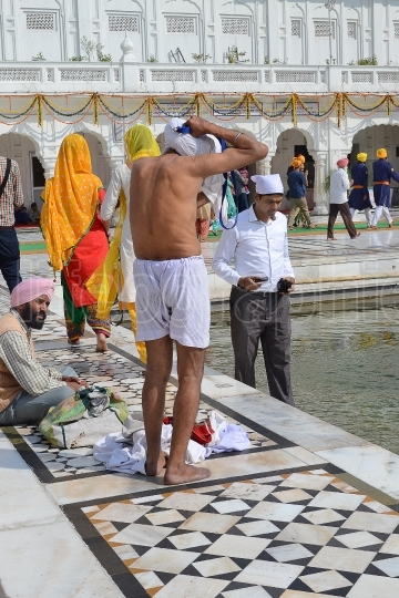 People Bathing Golden Temple