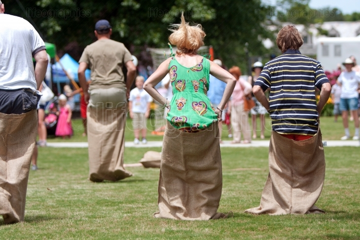 People Compete In Sack Race At Spring Festival