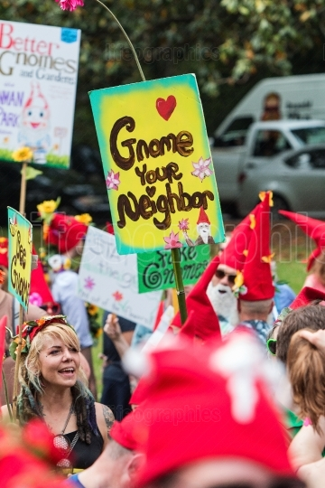 People Dressed Like Gnomes Hold Signs At Atlanta Festival Gathering