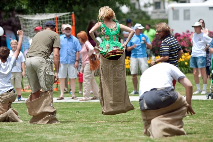 People Jump In Sack Race At Spring Festival