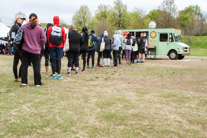 People Stand In Long Line To Order From Food Truck