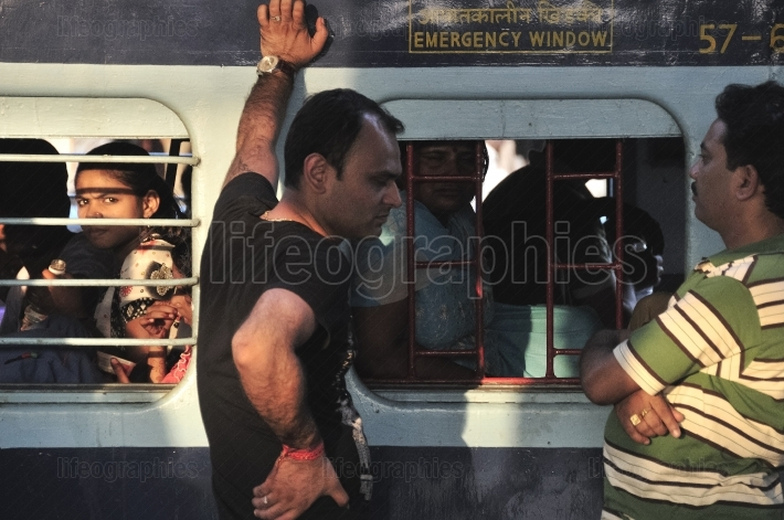 People traveling by train from delhi to agra