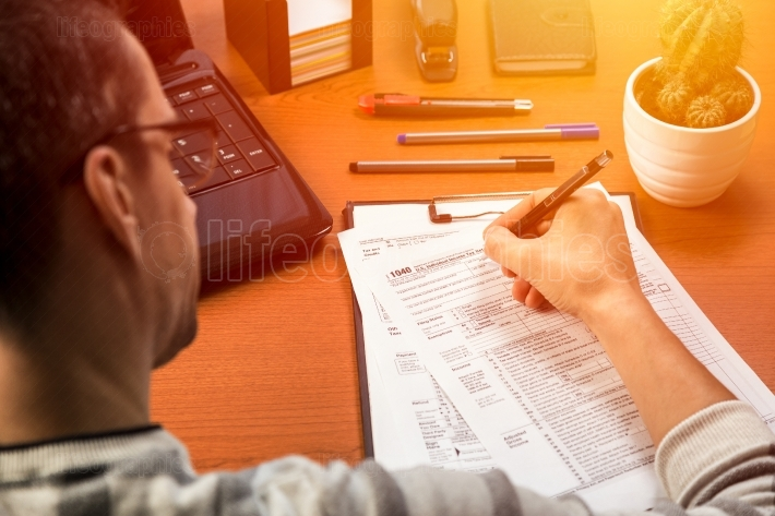 Person completing 1040 tax form