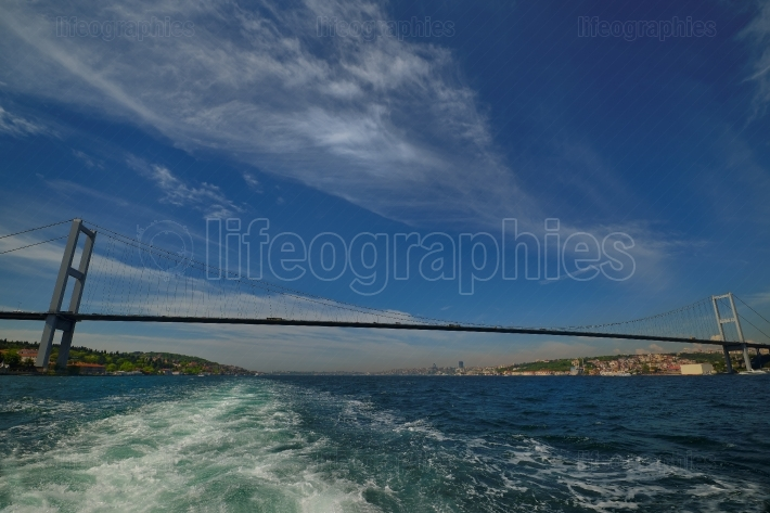 Photo of The Bosphorus Bridge of Istanbul. It unites two different continents, Asia and Europe.