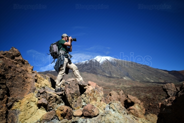 Photographer outdoor in summer in Tiede crater, Tenerife, Spain