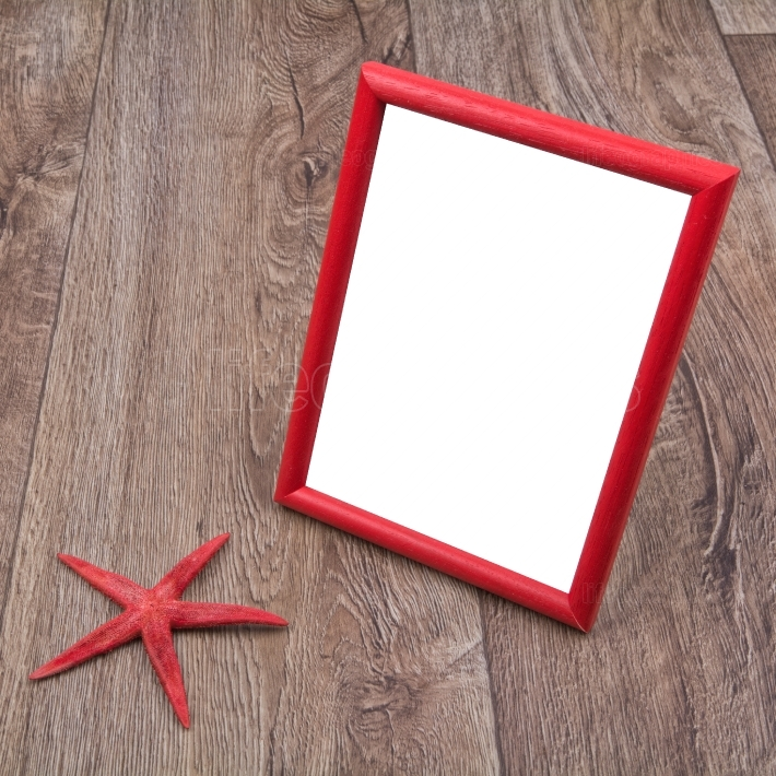 Picture frame and starfish on a wooden background
