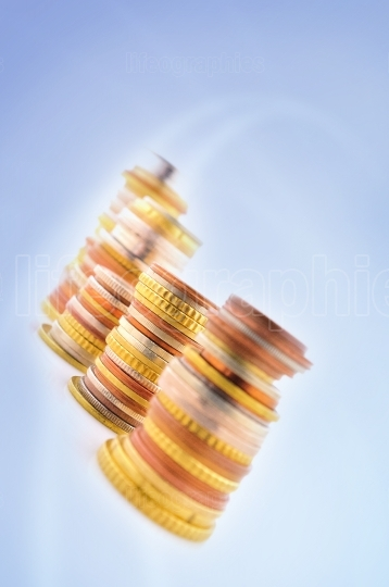 Piled coins on blue background