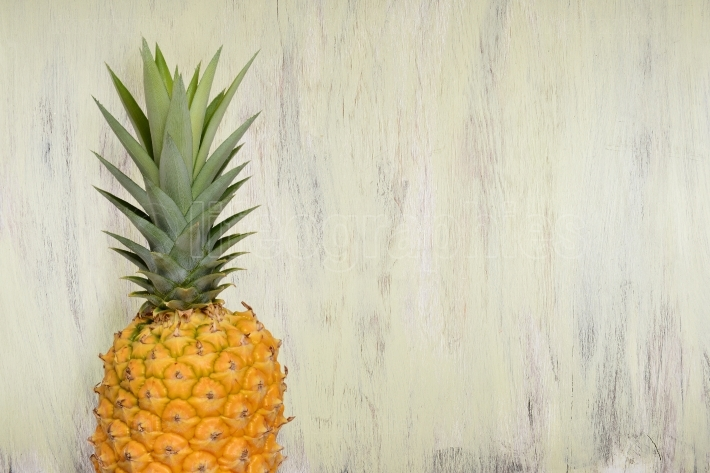 Pineapple on a Green Wood Background