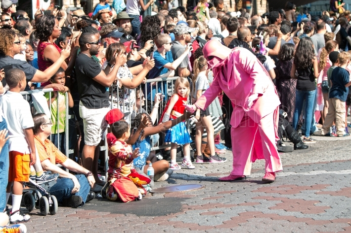 Pink darth vader interacts with atlanta dragon con parade specta
