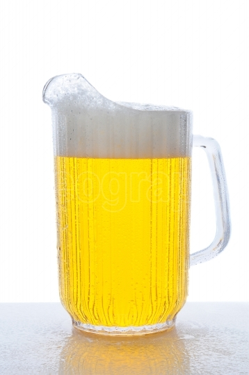 Pitcher of Beer on Wet Counter Top