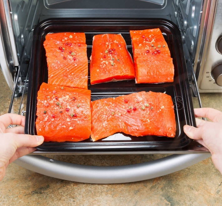 Placing Salmon into Oven for Baking