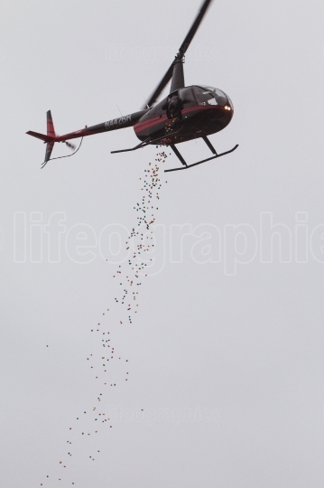 Plastic easter eggs get dropped from helicopter for community ev