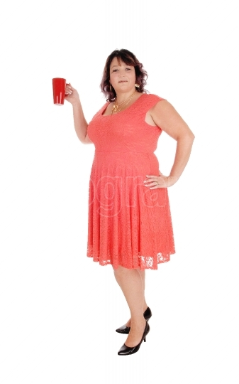 Plus sized woman holding a red mug