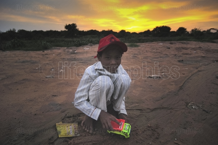 Poor cambodian kid playing