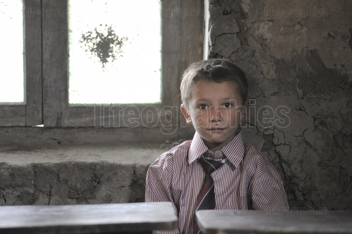 Poor kid at government school from  Shimshal village