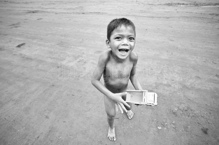 Poor kid in cambodia who are playing on the street