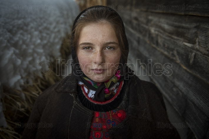 Portrait of a beautiful girl dressed in traditional clothes from tara lapusului