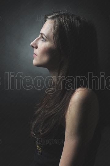 Portrait of a beautiful girl (side view)