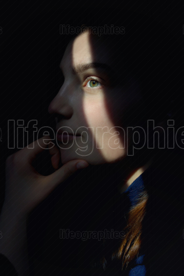 Portrait Of A Girl With Sun Rays On Face