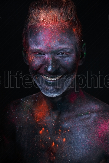 Portrait of a man painted in fluorescent UV colors
