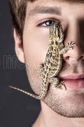 Portrait of a Young Handsome Man with Lizard on His Face