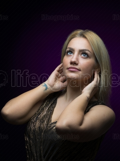 Portrait of beautiful female model on black background