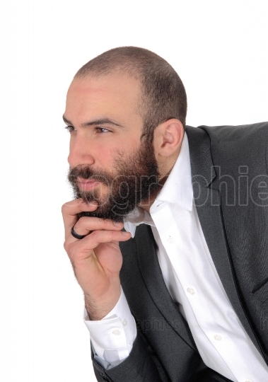 Portrait of businessman with hand on his chin thinking