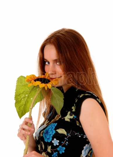 Portrait of girl with sunflower