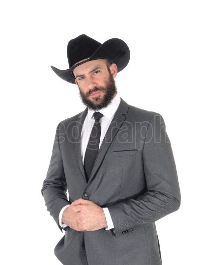Portrait of man in a suit and cowboy hat