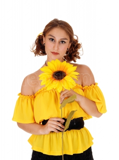 Portrait of woman with sunflowers.